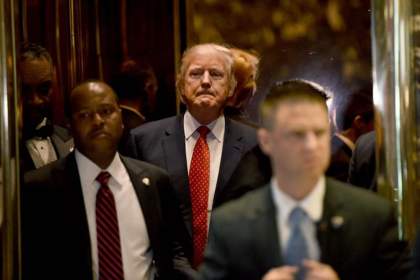 Donald Trump exiting the elevator at Trump Tower in New York on Jan 9, 2017.