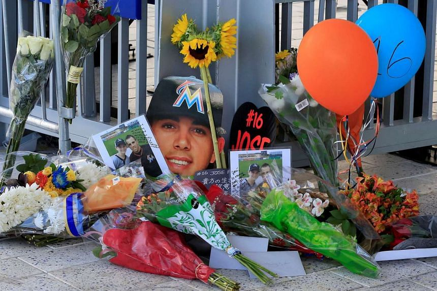 A memorial of flowers and photos are placed outside a gate at Marlins Park in honour of Miami Marlins starting pitcher Jose Fernandez who was killed in a boating accident in Miami, Florida, on Sept 25, 2016.
