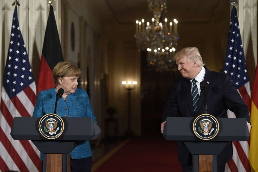 Donald Trump and Angela Merkel hold a joint press conference in the East Room of the White House.