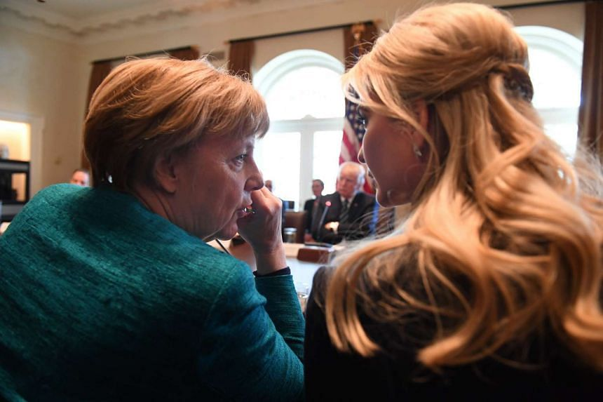 Merkel (left) talks with Ivanka Trump during a roundtable discussion on vocational training with business leaders at the White House.