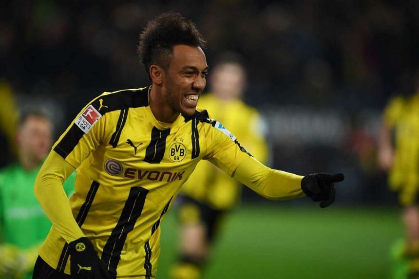 Dortmund's Pierre-Emerick Aubameyang celebrates scoring the opening goal during the German First division Bundesliga football match Borussia Dortmund vs Ingolstadt in Dortmund, western Germany on March 17, 2017.