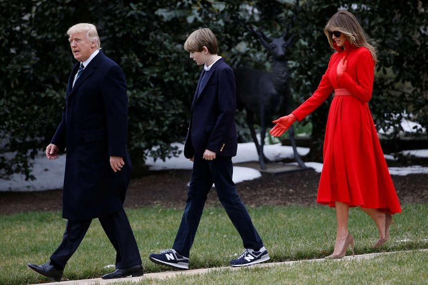 Donald Trump and wife Melania walk with their son Barron to Marine One at the White House,  March 17, 2017.