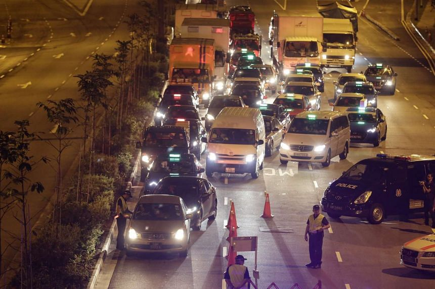 Traffic Police conducting checks at a road block on Keppel Road in the wee hours of Saturday (March 18).