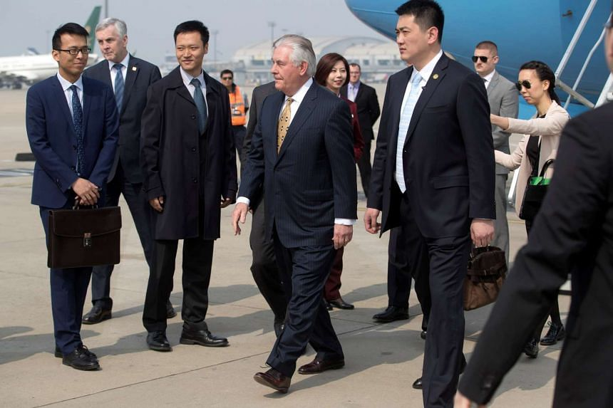 US Secretary of State Rex Tillerson (centre) arriving at Beijing Capital International Airport on March 18, 2017.