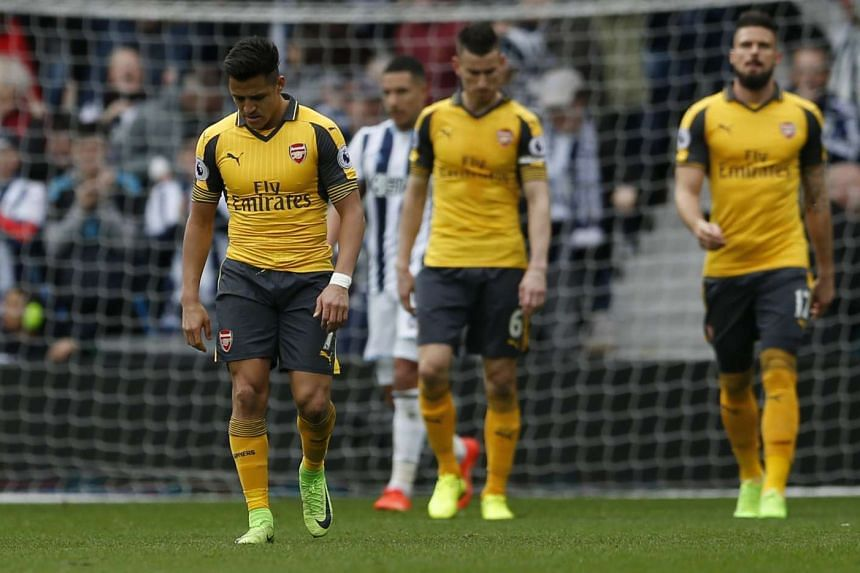 Arsenal players reacting after West Bromwich Albion's Craig Dawson scored his team's third goal against them, during their EPL match on March 18, 2017.