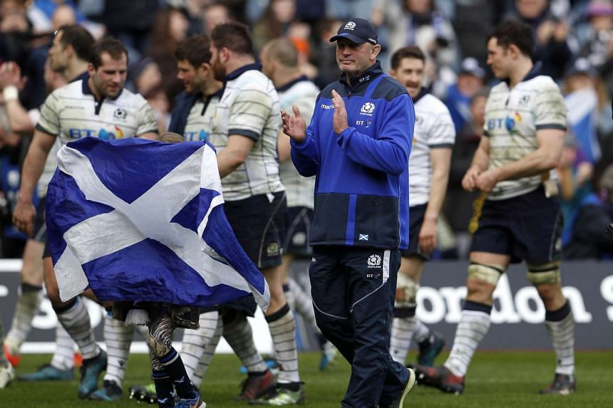 Scotland's Vern Cotter with daughter Anabella celebrate on the pitch with the team at the end of the match.