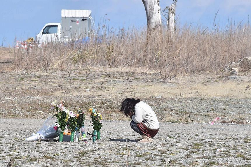 A woman praying for the victims of the disaster in Fukushima last Saturday, the sixth anniversary of the tragedy.