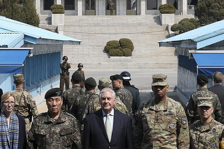 Mr Tillerson with UN, American and South Korean military commanders at the border village of Panmunjom separating the two Koreas yesterday.