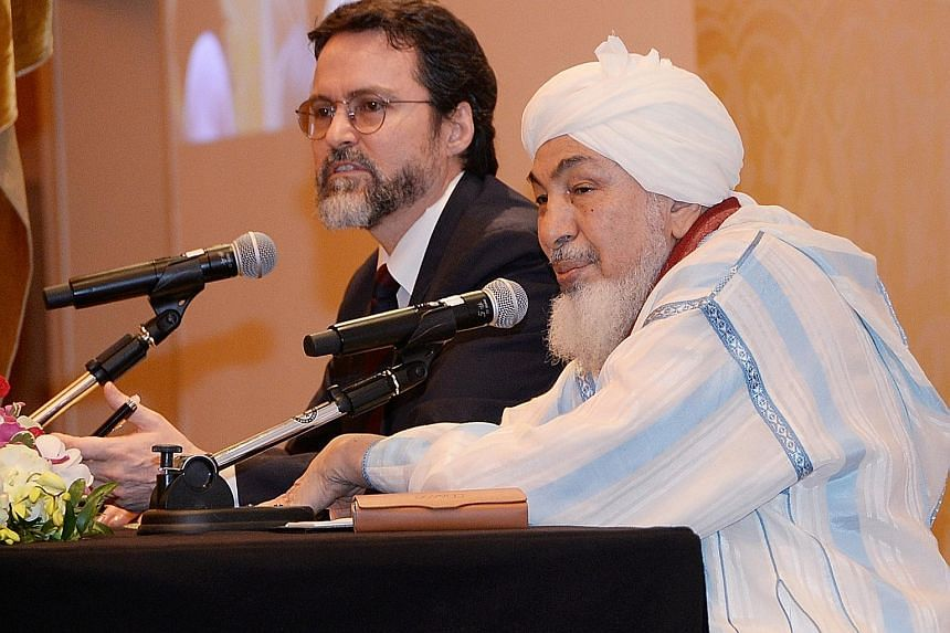 Shaykh Abdallah (in white) stressed yesterday that Islam carries the message of peace and embraces diversity. Beside him is Shaykh Hamza Yusuf, vice-president of the Forum for Promoting Peace in Muslim Societies.