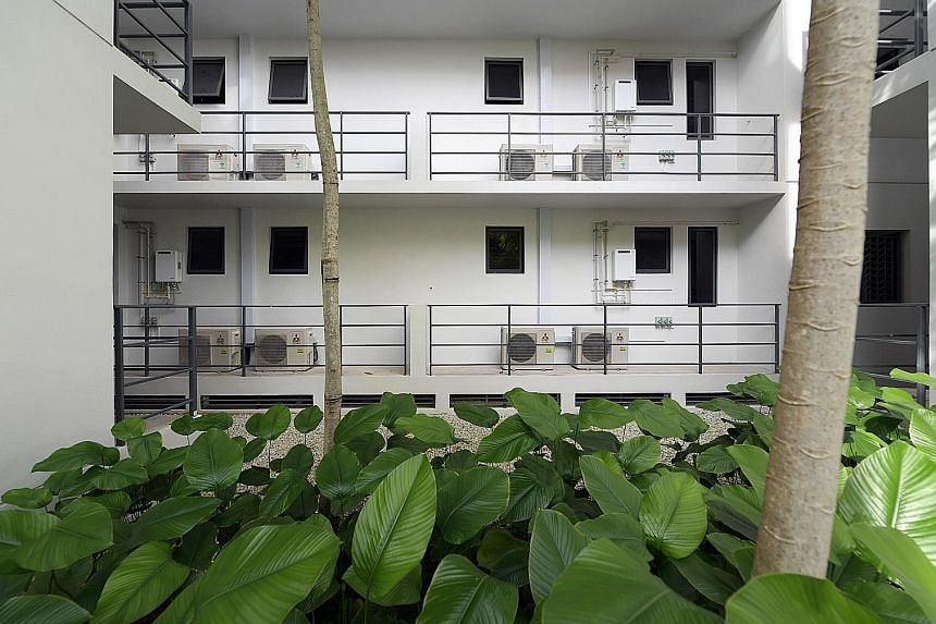 """A band of some 200 homeowners in La Fiesta in Sengkang are now irate over """"massive"""" air-con ledges (above) in their homes."""