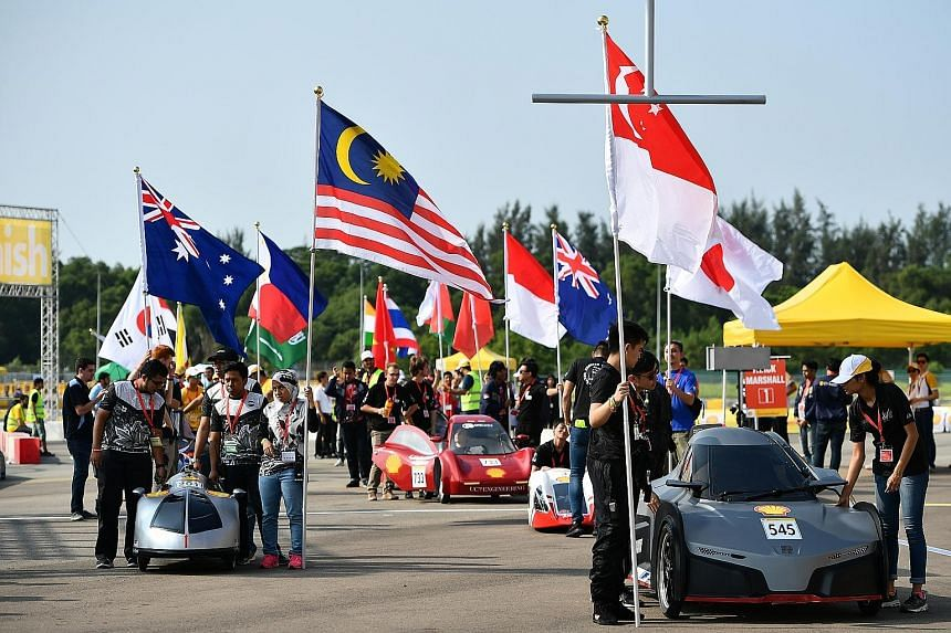 Teams at the starting line at the Shell Eco-marathon Asia competition yesterday. The search for sustainable urban solutions was urgent and required coordinated action, said DPM Teo at the contest's launch.