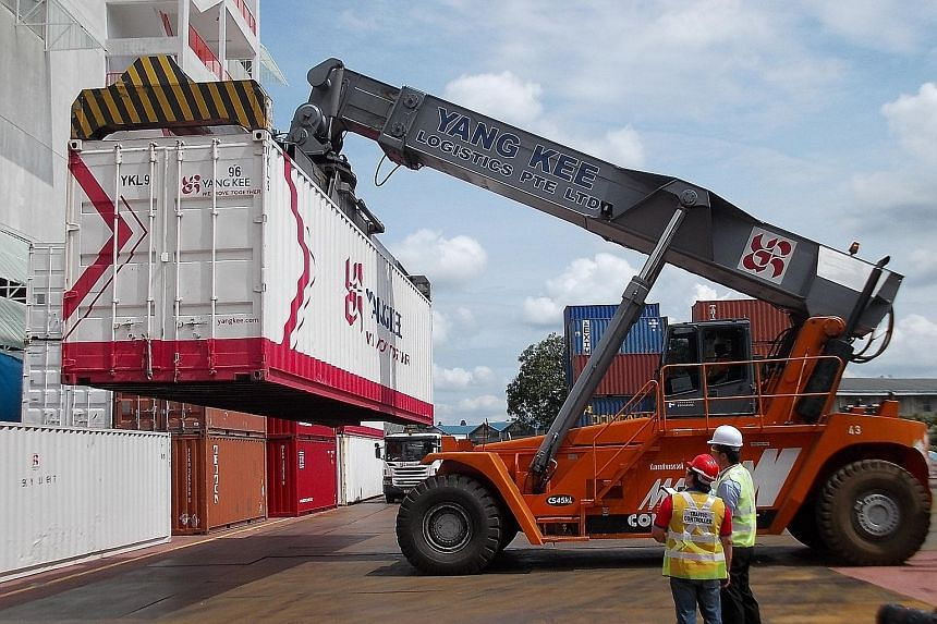Yang Kee Logistics' operations in Singapore (above). Its group chief executive Ken Koh says IE Singapore has been instrumental in helping the company to tap on merger and acquisition opportunities abroad.