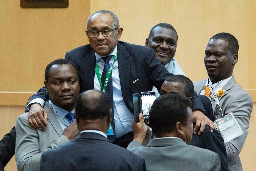 Above: Madagascar's Ahmad Ahmad (second from left) is carried after winning an election to become the president of the Confederation of African Football in Addis Ababa. He beat incumbent Issa Hayatou (left) in a 34-20 vote.