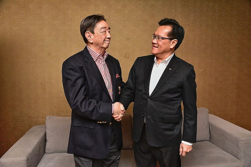 """Teo Hock Seng (left), Komoco's group managing director, and Lim Kia Tong, FAS' interim chief, after the media conference for the annual Sultan of Selangor's Cup. Lim is glad to have the """"godfather of Singapore football"""" in his slate as he considers h"""