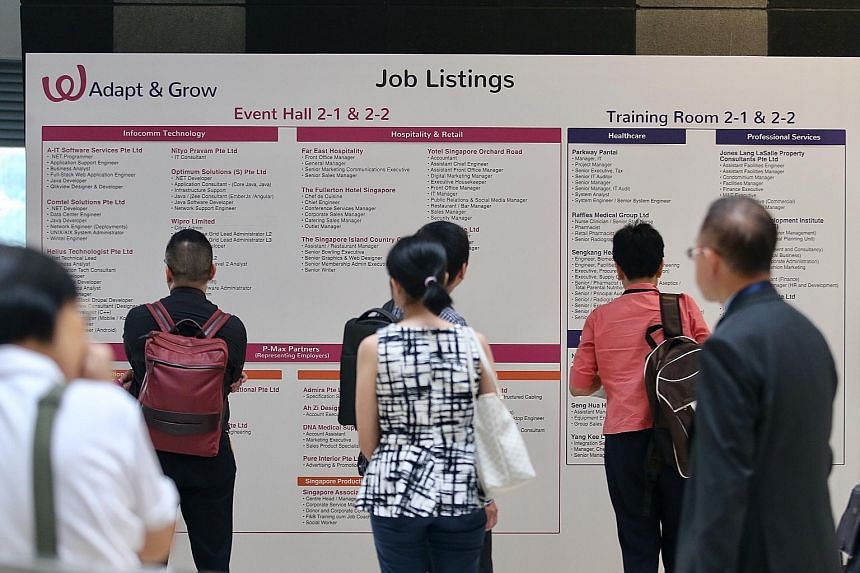 Job seekers at a fair organised by Workforce Singapore and the Employment and Employability Institute yesterday. Unemployed PMETs can look forward to more such smaller-scale job fairs in a bid to help PMETs find work sooner, and keep the long-term un