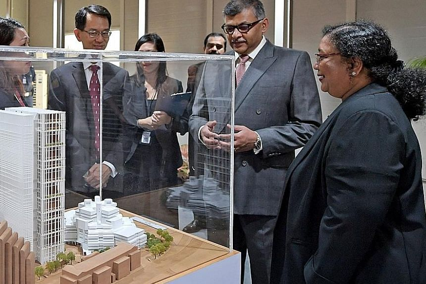 The new State Courts Towers, currently being built, will cost $450 million and are expected to be operational from 2020. Viewing a model of the new State Courts Towers are (from far left) District Judge Wong Peck (partially hidden), Presiding Judge o