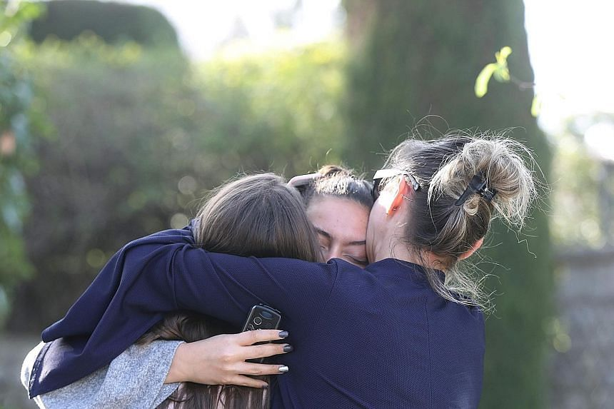 People reacting to the school shooting in Grasse, France, on Thursday. Three students and the principal suffered minor gunshot injuries; another 10 students were treated for shock or injuries from a stampede.