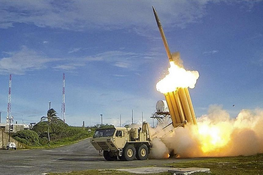 A handout photo made available by the US Department of Defence showing the launch of a Thaad interceptor in the US in 2013. China is opposed to the deployment of Thaad in South Korea as it believes the system's powerful radars can be used to spy on C