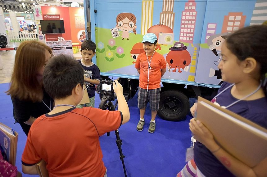 Pupils turned picture editors yesterday as they decided which picture of Joseph Schooling should be used for their story at the ST Young Storymakers Camp, a highlight of the sixth SmartKids Asia exhibition. The children got to have their byline photo