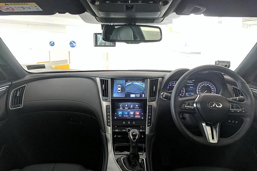 Most interior surfaces are lavishly wrapped in double-stitched leather, but the dual-touchscreen infotainment system is chaotic.