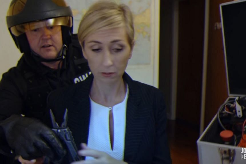 """""""BBC mum"""" in the Jono And Ben parody defuses a bomb while being interviewed on air."""