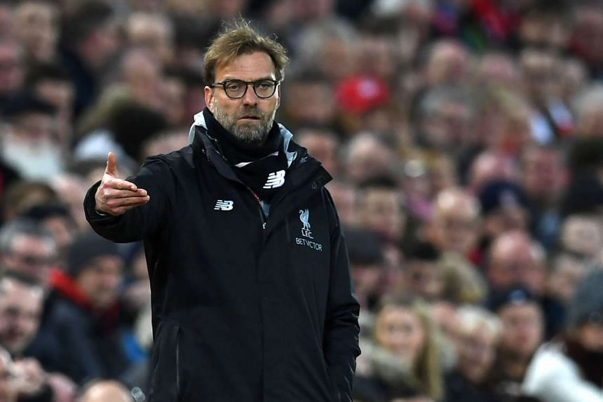Liverpool's German manager Jurgen Klopp gesturing on the touchline during the English Premier League football match against Arsenal on March 4, 2017.