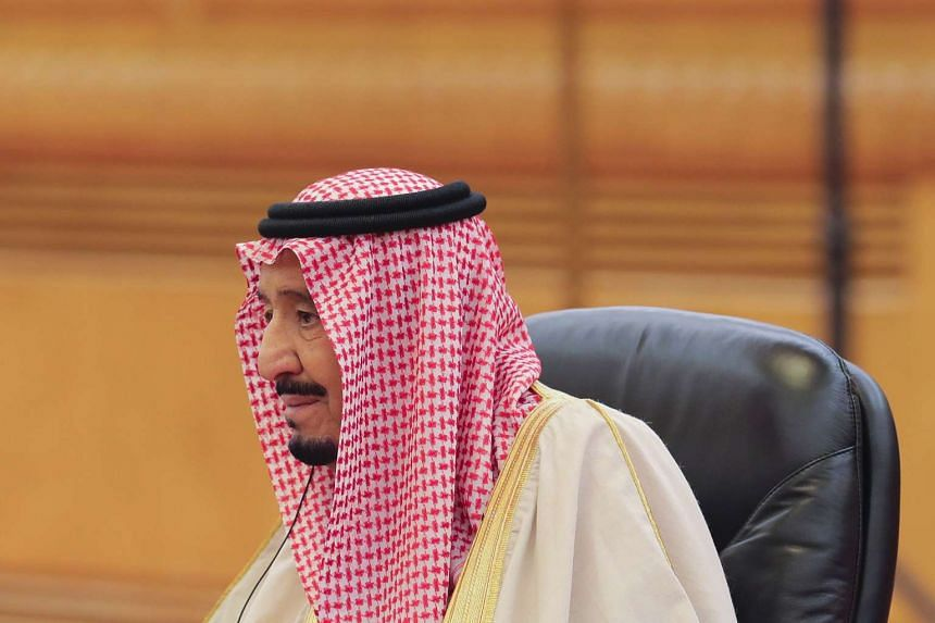 Saudi King Salman bin Abdulaziz taking part in a meeting with Chinese President Xi Jinping (not pictured) at the Great Hall of the People in Beijing on March 16, 2017.
