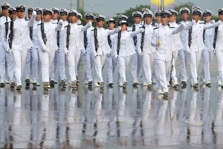Graduating naval cadets marching past during the commissioning parade for the 104/16 Officer Cadet Course, on March 18, 2017.