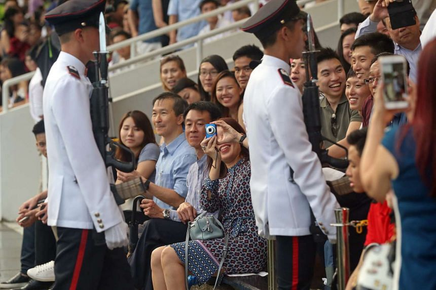 Family members and friends of graduating officer cadets watching the commissioning parade and taking photos, at Safti Military Institute on March 18, 2017.