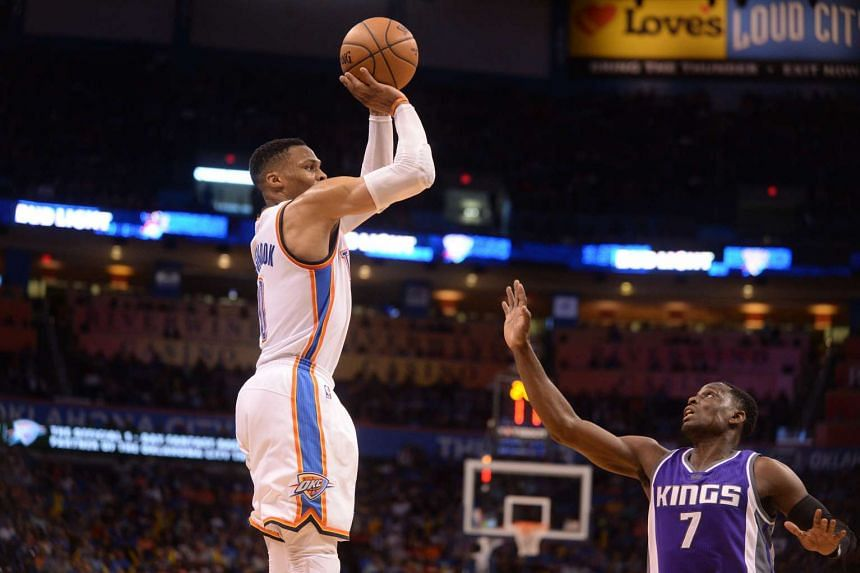 Oklahoma City Thunder guard Russell Westbrook shoots the ball over Sacramento Kings guard Darren Collison during the second quarter at Chesapeake Energy Arena.