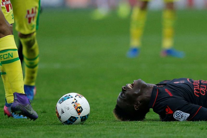 Nice's Mario Balotelli reacts to the results.