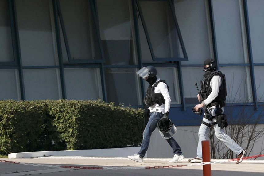 Police inside Tocqueville high school after a shooting, in Grasse, southern France, March 16, 2017.