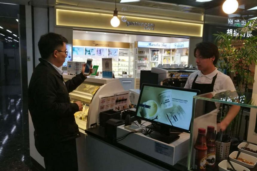 A customer in Beijing making payment by phone. China had 469 million mobile payment users last year.