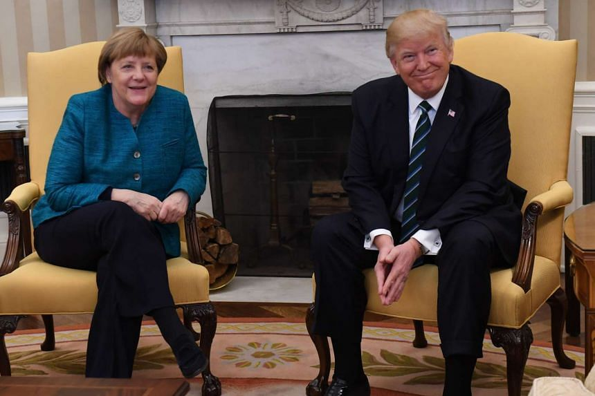 US President Donald Trump, and Angela Merkel, Germany's chancellor, left, attend a meeting in the Oval Office of the White House in Washington, on Friday, March 17, 2017.