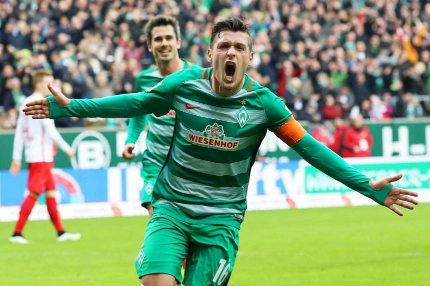 Bremen's Zlatko Junizovic celebrates after scoring the 1-0 lead.