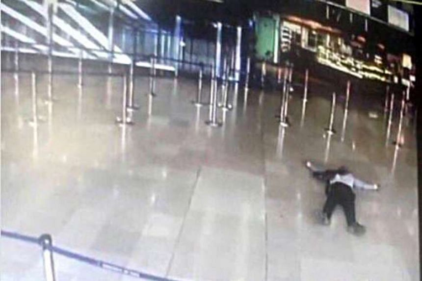 An airport CCTV screen image shows a man on the ground after the incident at Orly Sud terminal, March 18, 2017.