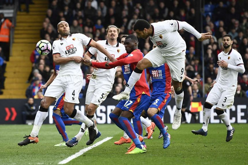 Watford's Troy Deeney scores an own goal to give Palace a 1-0 win.