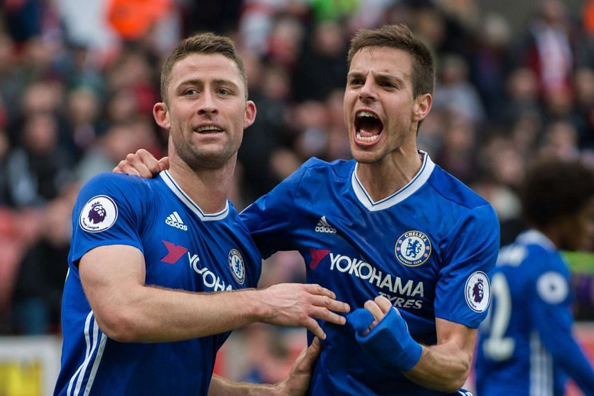 Chelsea's Gary Cahill (left) is congratulated after scoring the third goal.