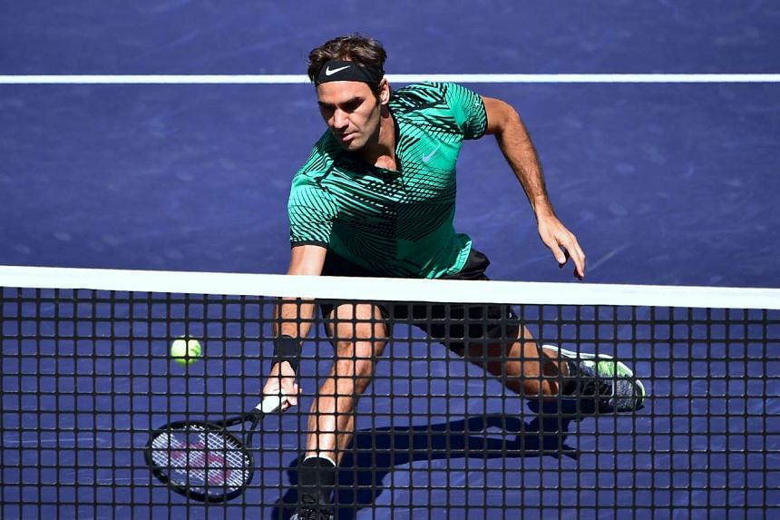 Federer reaches for a forehand return to Jack Sock of the US.
