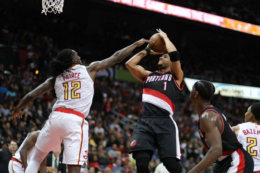 Portland Trail Blazers guard Evan Turner (1) attempts a shot against Atlanta Hawks forward Taurean Prince (12) in the third quarter of their game at Philips Arena.