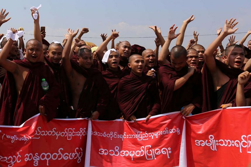 Monks and ethnic Mon shout slogans during a rally in Mawlamyine in Myanmar's Mon State on March 19, 2017.