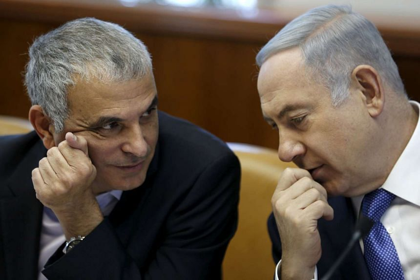 Israeli Prime Minister Netanyahu speaks with Finance Minister Kahlon during the weekly cabinet meeting in Jerusalem.