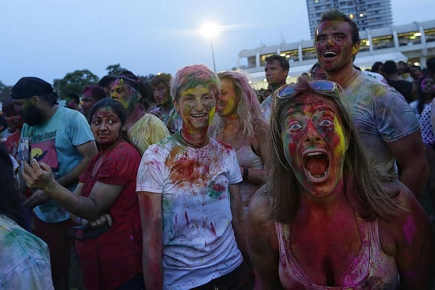 Their faces smeared with powder, revellers smiled for the camera as they celebrated Holi yesterday evening. About 6,500 descended upon the open field at Kampong Kembangan Community Club for the 12th Rang De Holi Festival. From 4pm onwards, they were