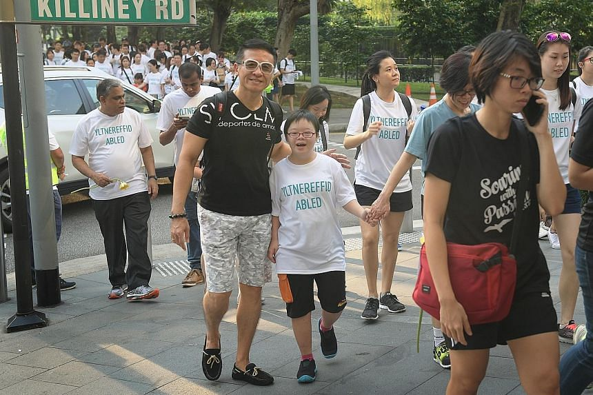The 2.2km buddy walk yesterday began from Dhoby Ghaut Green, which was also the site of a carnival. Down syndrome affects about one in 800 babies worldwide.