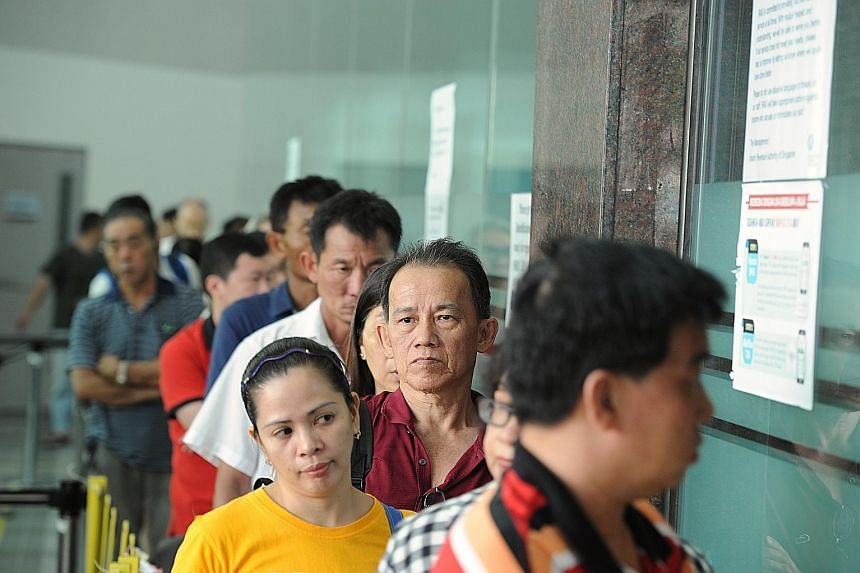 People queueing to file their tax returns at the Inland Revenue Authority of Singapore's office in Newton Road on April 13 last year as the deadline for filing taxes loomed. Skip the queues and file your taxes online instead.
