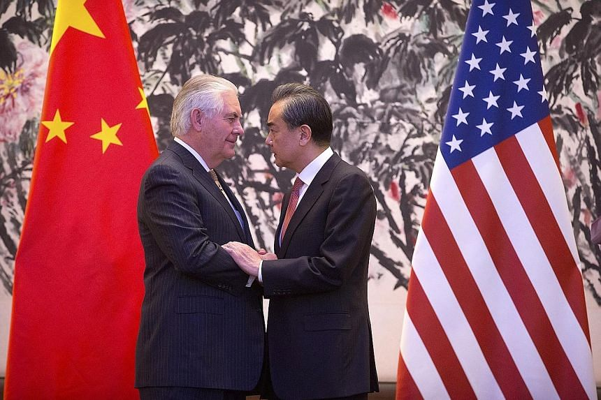 Mr Tillerson and Mr Wang after their joint press conference at Diaoyutai State Guesthouse in Beijing yesterday. Besides commenting on Pyongyang's nuclear programme, both men also discussed wide-ranging bilateral and regional issues, including maritim