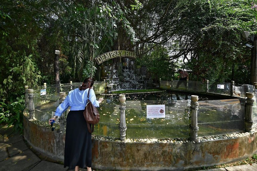 A glass barrier around the turtle pond at Kong Meng San Phor Kark See Monastery (above) stops visitors from throwing things inside, while a sign at a pond in Dempsey Hill (left) urges people not to throw coins into it.