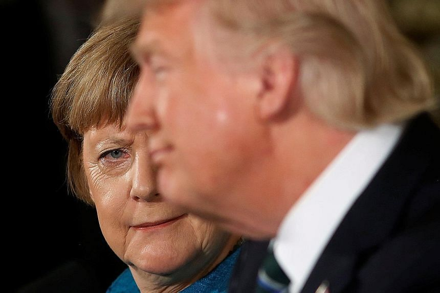 Germany's Chancellor Angela Merkel giving US President Donald Trump a look after he quipped how they might have both been wiretapped by his predecessor Barack Obama, during their joint news conference on Friday. The Obama administration's spying infu
