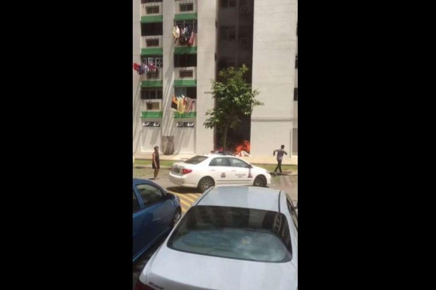 A fire broke out below an HDB block in Woodlands on Sunday (March 19).