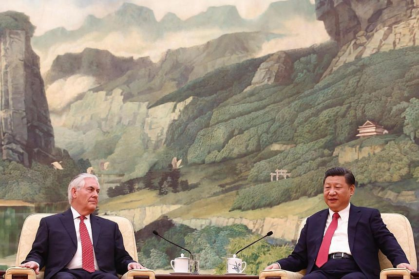 China's President Xi Jinping (right) meets US Secretary of State Rex Tillerson at the Great Hall of the People in Beijing on March 19, 2017.